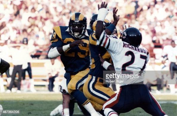 Eric Dickerson of the Los Angeles Rams carries the ball as Mike Richardson of the Chicago Bears looks to make the tackle during at Anaheim Stadium on...