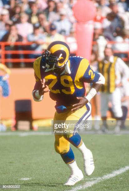 Eric Dickerson of the Los Angeles Rams in action against the Houston Oilers during an NFL football game December 9 1984 at Anaheim Stadium in Anaheim...