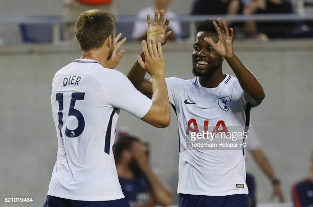 Eric Dier and Josh Onomah of Tottenham Hotspurs celebrate after Dier scored a firsthalf goal against Paris SaintGermain during a International...