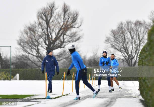 Eric Dier and Mousa Dembele of Tottenham Hotspur throw snowballs at Kieran Trippier of Tottenham Hotspur during a Tottenham Hotspur Training Session...