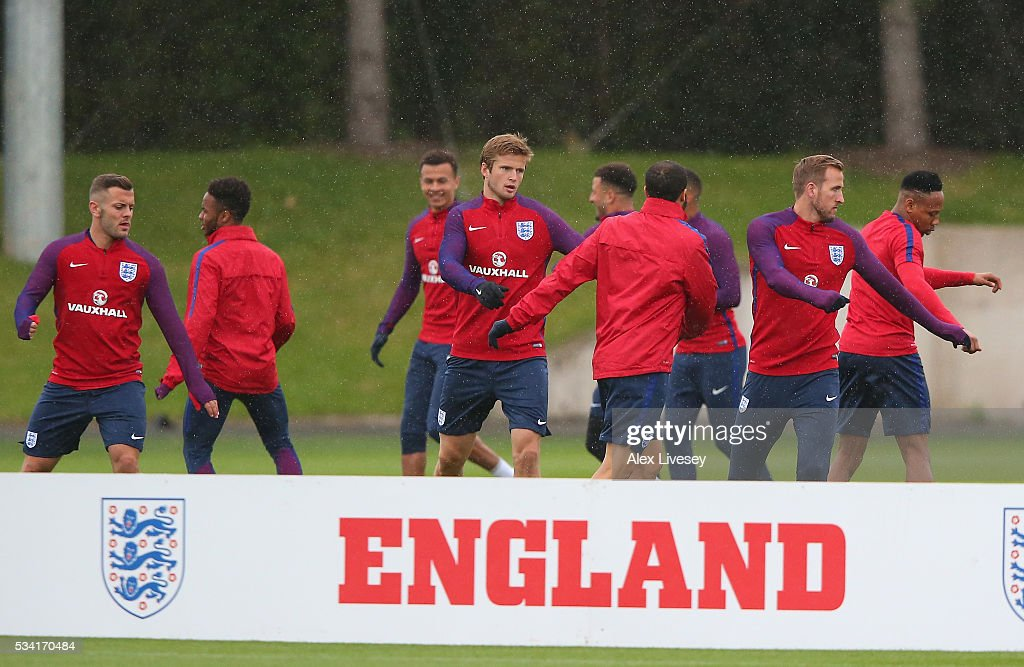 Eric Dier and the England squad warm up during the England training session at Manchester City Football Academy on May 25, 2016 in Manchester, England.