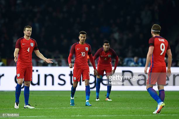 Eric Dier Dele Alli and Harry Kane of England reacts after Germany's 2nd goal during the International Friendly match between Germany and England at...