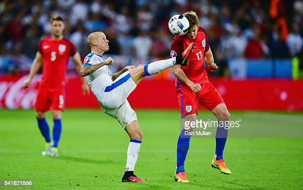 Eric Dier of England and Vladimir Weiss of Slovakia compete for the ball during the UEFA EURO 2016 Group B match between Slovakia and England at...