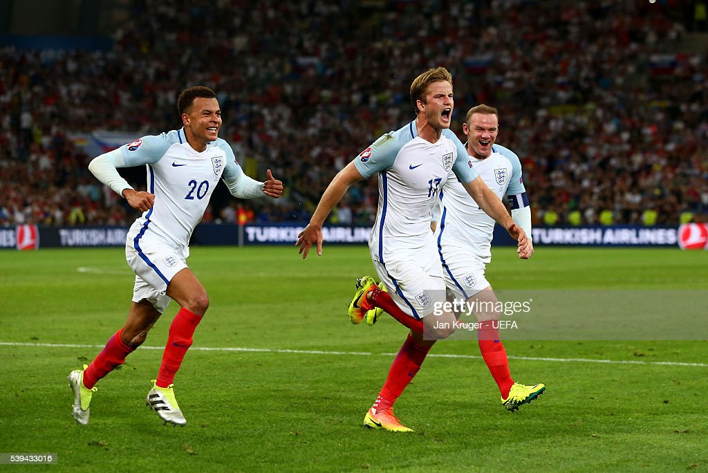 Eric Dier (C) of England celebrates scoring his team's first goal with his team mates Dele Alli (L) and Wayne Rooney (R) during the UEFA EURO 2016 Group B match between England and Russia at Stade Velodrome on June 11, 2016 in Marseille, France.