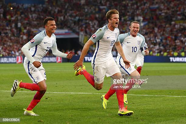 Eric Dier of England celebrates scoring his team's first goal with his team mates Dele Alli and Wayne Rooney during the UEFA EURO 2016 Group B match...