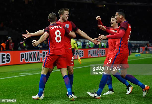 Eric Dier of England celebrates scoring his team's third goal with his team mates Jordan Henderson Ross Barkley and Chris Smalling during the...