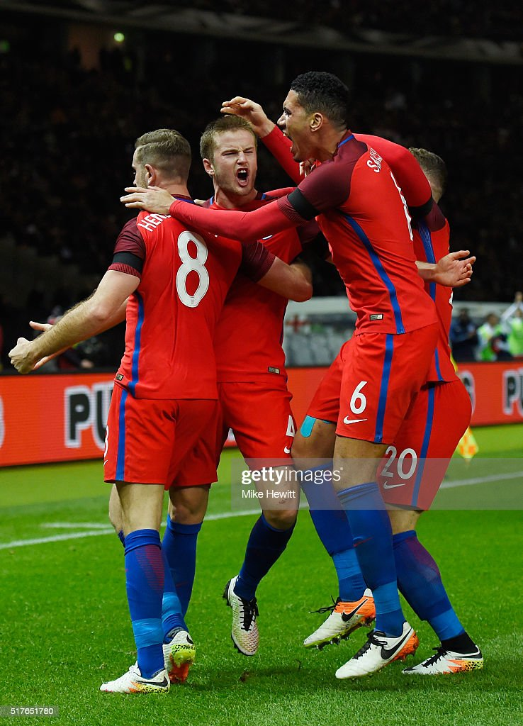 Eric Dier (2nd L) of England celebrates scoring his team's third goal with his team mates Jordan Henderson (1st L), Ross Barkley (1st R) and Chris Smalling (2nd R) during the International Friendly match between Germany and England at Olympiastadion on March 26, 2016 in Berlin, Germany.