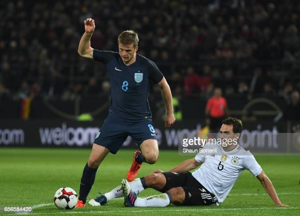 Eric Dier of England escapes a challenge from Mats Hummels of Germany during the international friendly match between Germany and England at Signal...