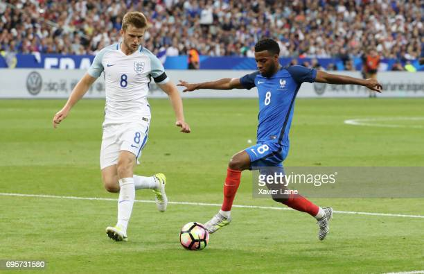 Eric Dier of England in action with Thomas Lemar of France during the International Friendly match between France and England at Stade de France on...