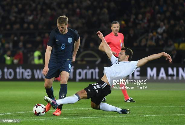 Eric Dier of England is tackled by Mats Hummels of Germany during the international friendly match between Germany and England at Signal Iduna Park...