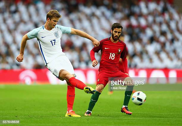 Eric Dier of England is watched by Rafa Silva of Portugal during the international friendly match between England and Portugal at Wembley Stadium on...