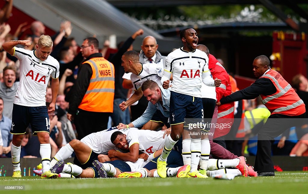 Eric Dier (obscured) of Spurs is congratulated by teammates after scoring the match winning goal during the Barclays Premier League match between West Ham United and Tottenham Hotspur at Boleyn Ground on August 16, 2014 in London, England.
