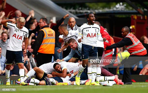 Eric Dier of Spurs is congratulated by teammates after scoring the match winning goal during the Barclays Premier League match between West Ham...