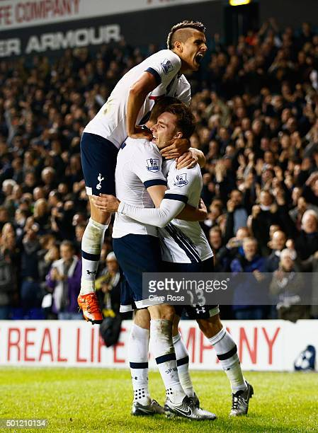 Eric Dier of Tottenham Hotspur celebrates with Erik Lamela and Christian Eriksen as he scores their first goal during the Barclays Premier League...