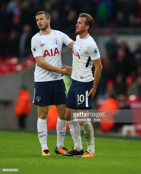 Eric Dier of Tottenham Hotspur checks on Harry Kane of Tottenham Hotspur as he holds his leg during the Premier League match between Tottenham...