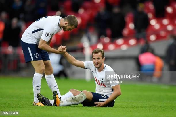 Eric Dier of Tottenham Hotspur checks that Harry Kane of Tottenham Hotspur is okay after going down holding his leg during the Premier League match...