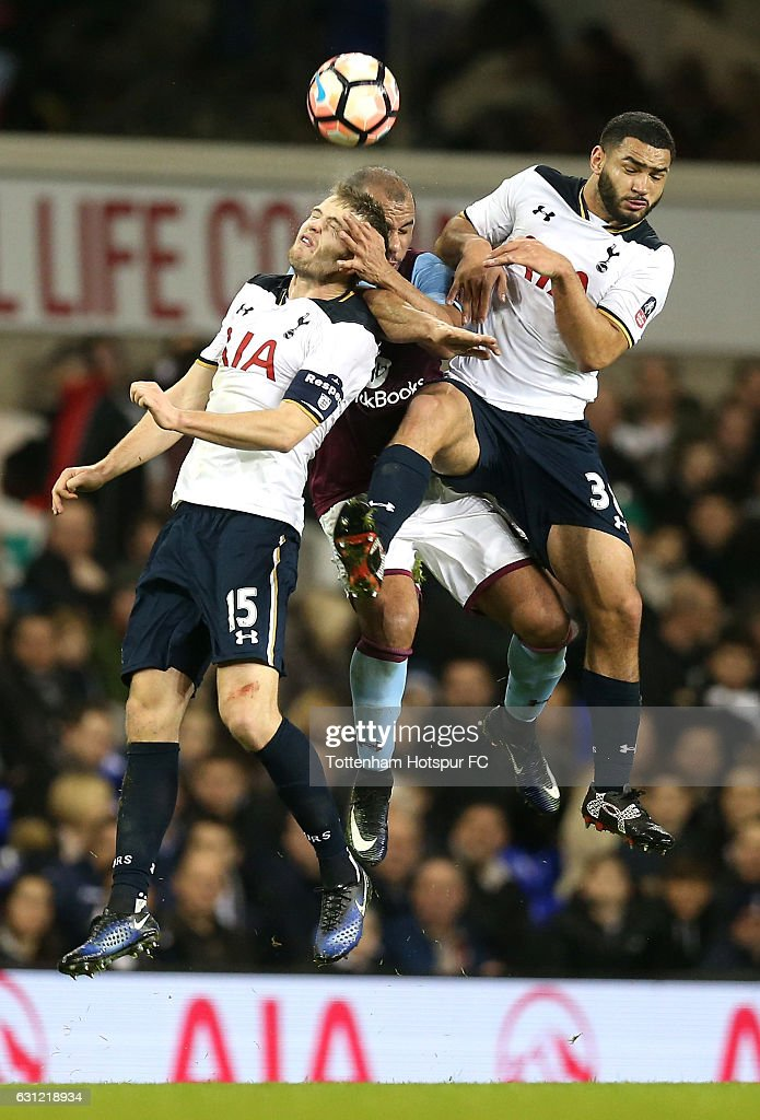 Eric Dier of Tottenham Hotspur (L), Gabriel Agbonlahor of Aston Villa (C) and Cameron Carter-Vickers of Tottenham Hotspur (R) battle to win a header during The Emirates FA Cup Third Round match between Tottenham Hotspur and Aston Villa at White Hart Lane on January 8, 2017 in London, England.