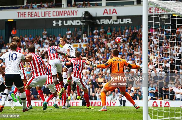 Eric Dier of Tottenham Hotspur heads the ball to scores his team's first goKelvin Davis of Southampton during the Barclays Premier League match...
