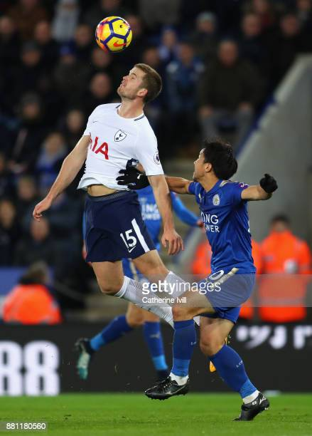 Eric Dier of Tottenham Hotspur is challenged by Shinji Okazaki of Leicester City during the Premier League match between Leicester City and Tottenham...
