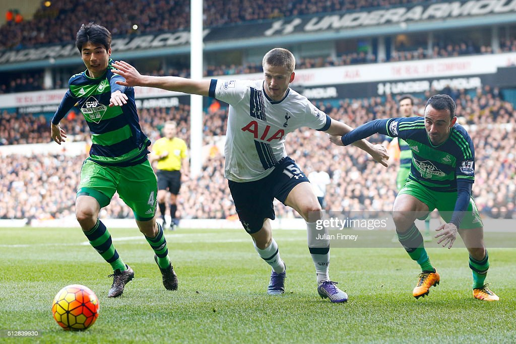 Eric Dier of Tottenham Hotspur is closed down by Ki SungYeung and Leon Britton of Swansea City during the Barclays Premier League match between...