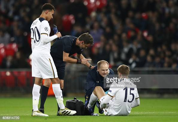 Eric Dier of Tottenham Hotspur receives treatment from the medical team during the UEFA Champions League Group E match between Tottenham Hotspur FC...