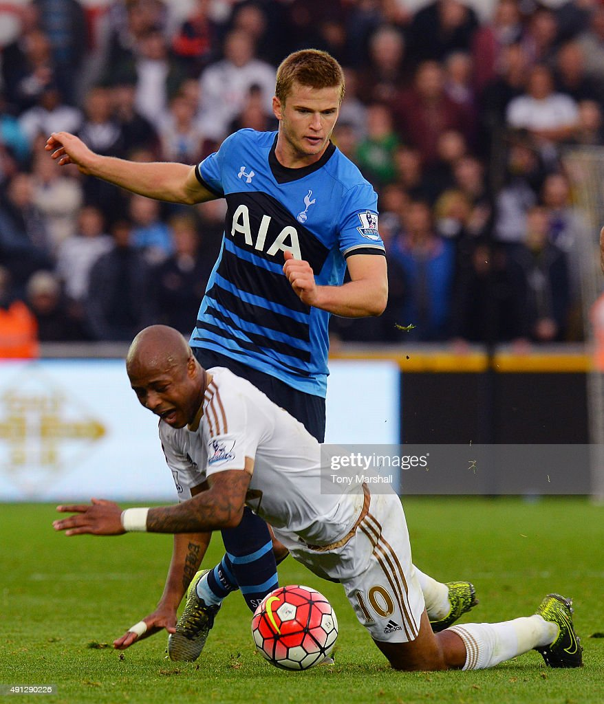 Eric Dier of Tottenham Hotspur tackles Andre Ayew of Swansea City during the Barclays Premier League match between Swansea City and Tottenham Hotspur at Liberty Stadium on October 4, 2015 in Swansea, Wales.
