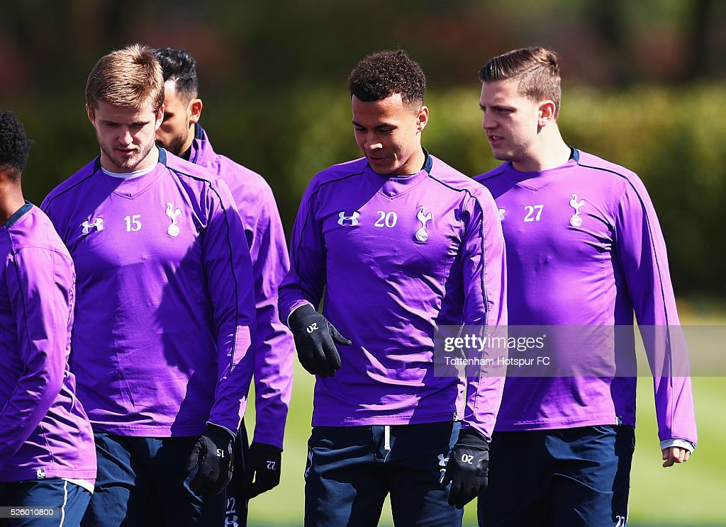 Eric Dier of Tottenham Hotspur talks with Dele Alli during a training session at the club's training ground on April 29, 2016 in Enfield, England.