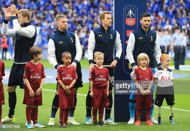 Eric Dier Toby Alderweireld Harry Kane and Hugo Lloris of Tottenham Hotspur line up with mascots including Marshall Janson prior to The Emirates FA...