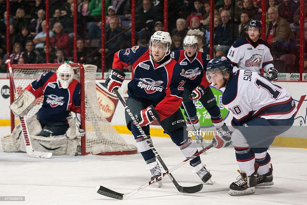 Eric Diodati #27 of the Windsor Spitfires skates against Dylan Sadowy #10 of the Saginaw Spirit on March 6, 2014 at the WFCU Centre in Windsor, Ontario, Canada.