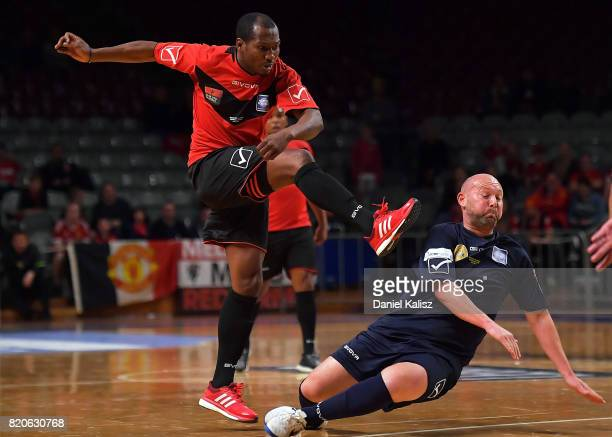 Eric Djemba Djemba of Manchester United strikes the ball as Steven McGarry of the ALeague All Stars defends during the match between the Manchester...