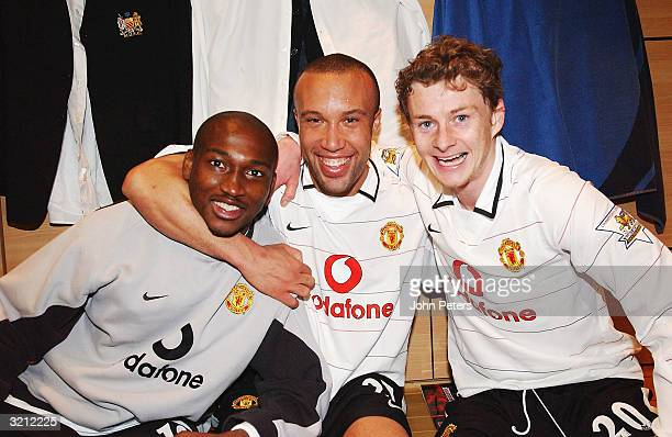 Eric DjembaDjemba Mikael Silvestre and Ole Gunnar Solskjaer celebrate in the dressing room after winning the AXA FA Cup match between Manchester...