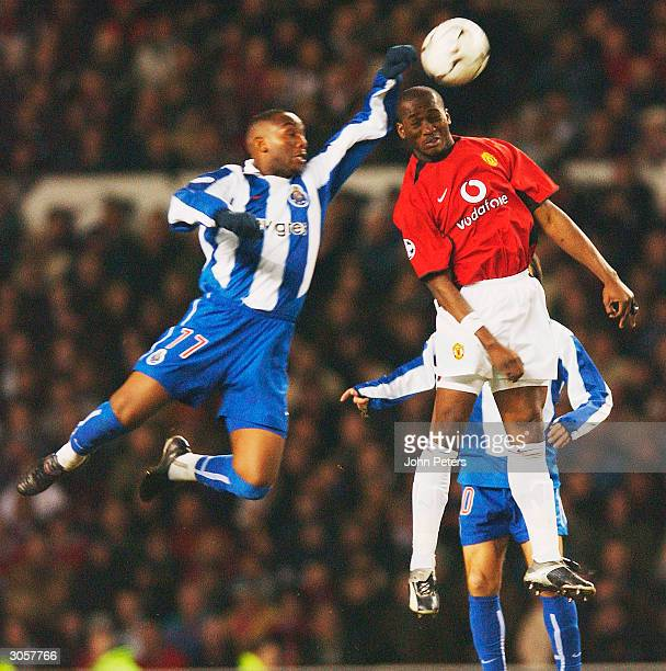 Eric DjembaDjemba of Manchester United clashes with Benni McCarthy of FC Porto during the UEFA Champions League match between Manchester United and...