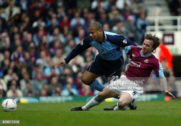 Eric Dloumeaux of West Ham United and David Connolly of Coventry in action during their Nationwide Division One match at Upton Park West Ham London...
