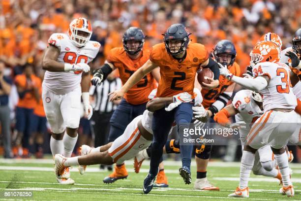 Eric Dungey of the Syracuse Orange runs for a first down in the final minutes of the game against the Clemson Tigers at the Carrier Dome on October...
