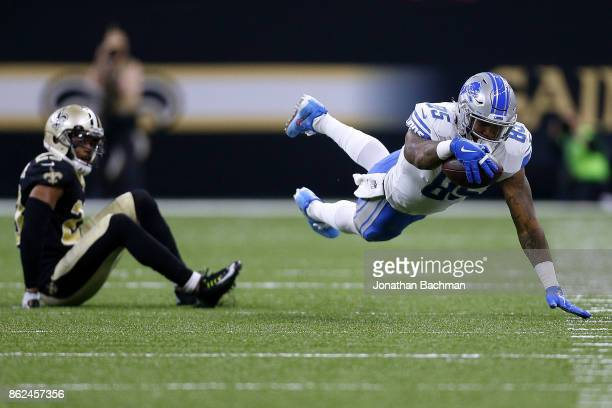 Eric Ebron of the Detroit Lions dives for a first down past Marshon Lattimore of the New Orleans Saints during the first half of a game at the...