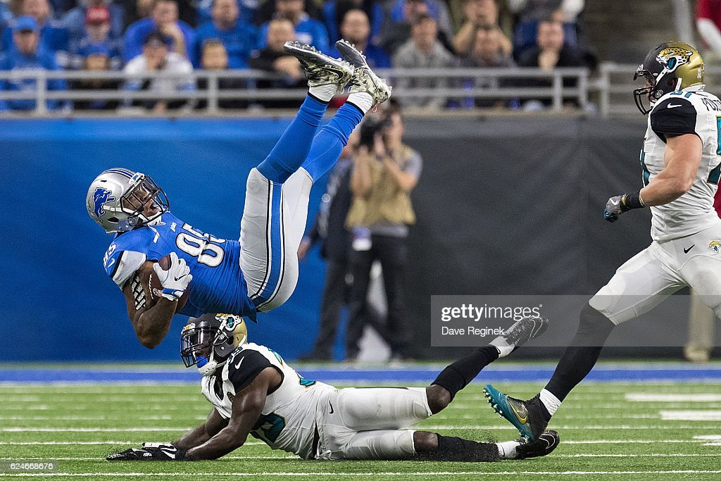 Eric Ebron #85 of the Detroit Lions is tackled by Tashaun Gipson #39 of the Jacksonville Jaguars during the second half of an NFL game at Ford Field on November 20, 2016 in Detroit, Michigan. The Lions defeated the Jaguars 26-19.