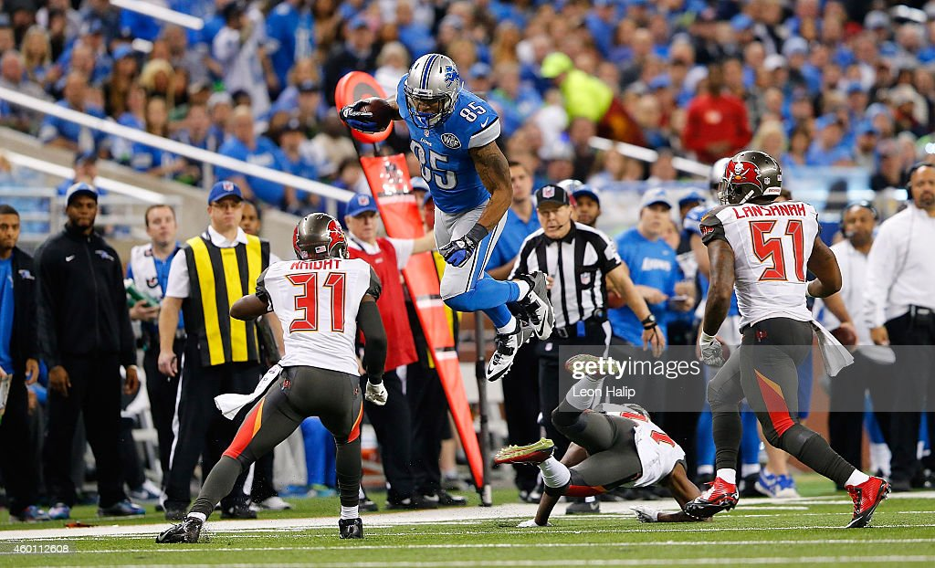 <a gi-track='captionPersonalityLinkClicked' href=/galleries/search?phrase=Eric+Ebron&family=editorial&specificpeople=8312199 ng-click='$event.stopPropagation()'>Eric Ebron</a> #85 of the Detroit Lions makes the catch and leaps over <a gi-track='captionPersonalityLinkClicked' href=/galleries/search?phrase=Johnthan+Banks&family=editorial&specificpeople=6393014 ng-click='$event.stopPropagation()'>Johnthan Banks</a> #27 of the Tampa Bay Buccaneers during the third quarter of the game at Ford Field on December 7, 2014 in Detroit, Michigan. The Lions defeated the Buccaneers 34-17.