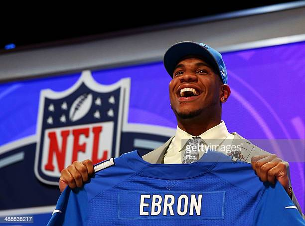 Eric Ebron of the North Carolina Tar Heels poses with a jersey after he was picked overall by the Detroit Lions during the first round of the 2014...