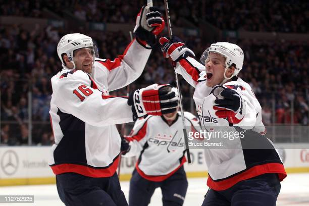 Eric Fehr and John Carlson of the Washington Capitals celebrate after Marcus Johansson scored a goal in the third period to tie the game 33 againsnt...