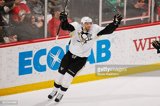 Eric Fehr of the Pittsburgh Penguins celebrates after scoring a goal against the Minnesota Wild during the game on December 26 2015 at the Xcel...