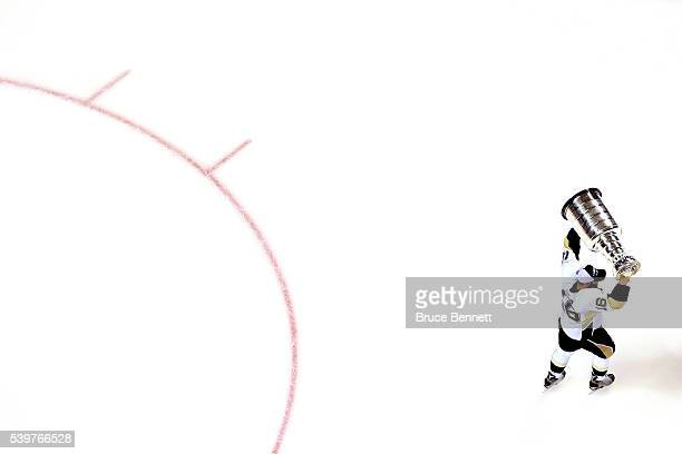 Eric Fehr of the Pittsburgh Penguins celebrates with the Stanley Cup after their 31 victory to win the Stanley Cup against the San Jose Sharks in...