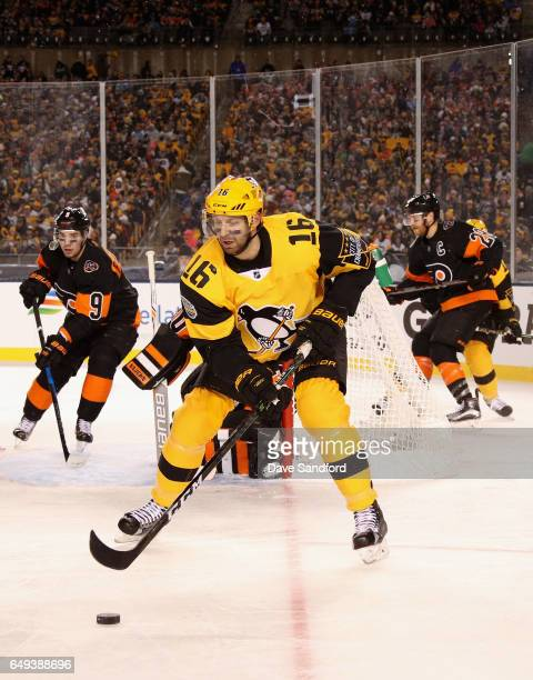 Eric Fehr of the Pittsburgh Penguins looks to control the puck in the first period of the 2017 Coors Light NHL Stadium Series at Heinz Field on...