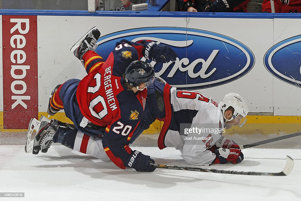 <a gi-track='captionPersonalityLinkClicked' href=/galleries/search?phrase=Eric+Fehr&family=editorial&specificpeople=566939 ng-click='$event.stopPropagation()'>Eric Fehr</a> #16 of the Washington Capitals and <a gi-track='captionPersonalityLinkClicked' href=/galleries/search?phrase=Sean+Bergenheim&family=editorial&specificpeople=208830 ng-click='$event.stopPropagation()'>Sean Bergenheim</a> #20 of the Florida Panthers come together along the boards at the BB&T Center on December 13, 2013 in Sunrise, Florida. The Panthers defeated the Capitals 3-2 in a shootout.
