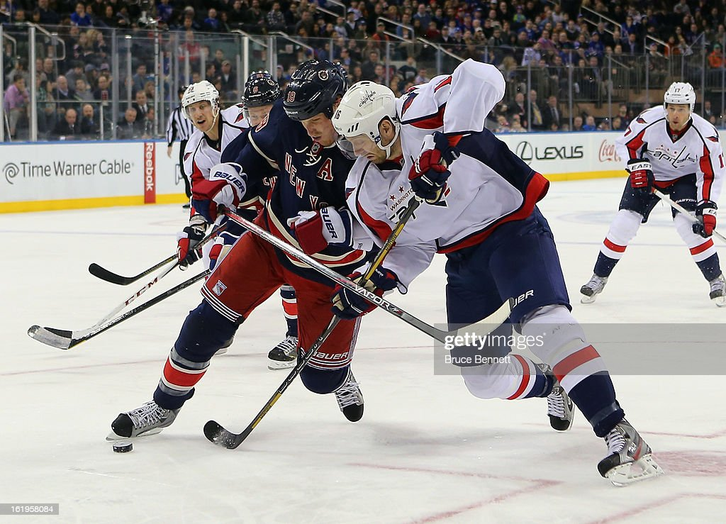<a gi-track='captionPersonalityLinkClicked' href=/galleries/search?phrase=Eric+Fehr&family=editorial&specificpeople=566939 ng-click='$event.stopPropagation()'>Eric Fehr</a> #16 of the Washington Capitals attempts to carry the puck around <a gi-track='captionPersonalityLinkClicked' href=/galleries/search?phrase=Marc+Staal&family=editorial&specificpeople=3809026 ng-click='$event.stopPropagation()'>Marc Staal</a> #18 of the New York Rangers at Madison Square Garden on February 17, 2013 in New York City. The Rangers defeated the Capitals 2-1.