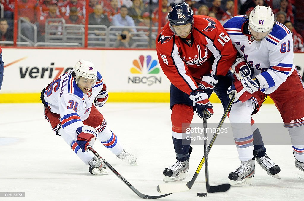 <a gi-track='captionPersonalityLinkClicked' href=/galleries/search?phrase=Eric+Fehr&family=editorial&specificpeople=566939 ng-click='$event.stopPropagation()'>Eric Fehr</a> #16 of the Washington Capitals battles for the puck against <a gi-track='captionPersonalityLinkClicked' href=/galleries/search?phrase=Mats+Zuccarello&family=editorial&specificpeople=7219903 ng-click='$event.stopPropagation()'>Mats Zuccarello</a> #36 and <a gi-track='captionPersonalityLinkClicked' href=/galleries/search?phrase=Rick+Nash&family=editorial&specificpeople=202196 ng-click='$event.stopPropagation()'>Rick Nash</a> #61 of the New York Rangers in Game One of the Eastern Conference Quarterfinals during the 2013 NHL Stanley Cup Playoffs at Verizon Center on May 2, 2013 in Washington, DC.
