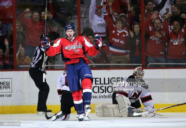 Eric Fehr of the Washington Capitals celebrates a shorthanded goal at 356 of the third period against Johan Hedberg of the New Jersey Devils at the...