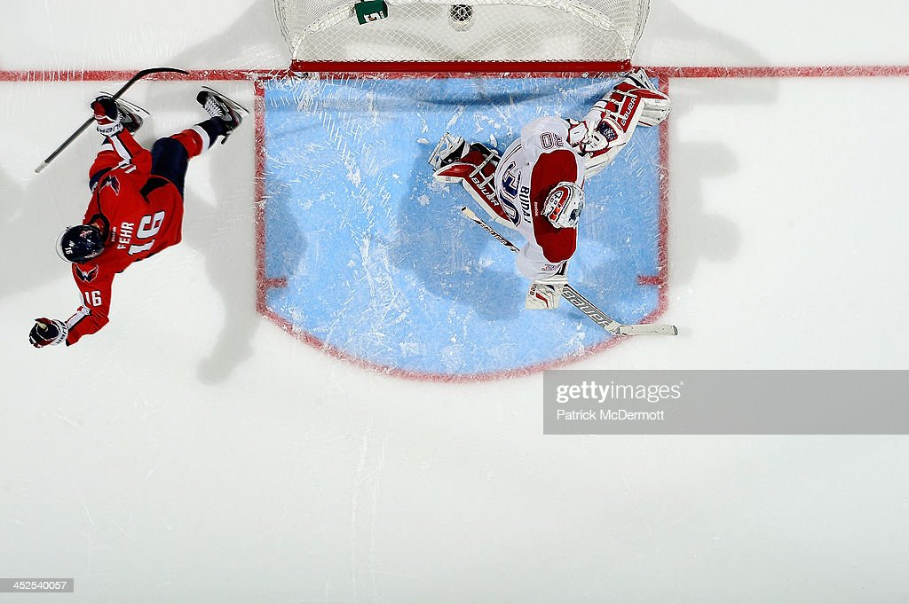 <a gi-track='captionPersonalityLinkClicked' href=/galleries/search?phrase=Eric+Fehr&family=editorial&specificpeople=566939 ng-click='$event.stopPropagation()'>Eric Fehr</a> #16 of the Washington Capitals celebrates after scoring a goal on <a gi-track='captionPersonalityLinkClicked' href=/galleries/search?phrase=Peter+Budaj&family=editorial&specificpeople=228123 ng-click='$event.stopPropagation()'>Peter Budaj</a> #30 of the Montreal Canadiens in an overtime shootout during an NHL game at Verizon Center on November 29, 2013 in Washington, DC. The Capitals defeated the Canadiens 3-2.
