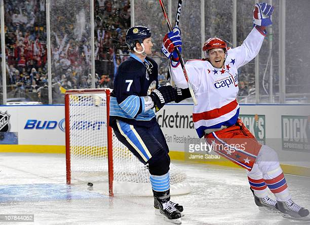 Eric Fehr of the Washington Capitals celebrates scoring in third period as Paul Martin of the Pittsburgh Penguins looks on during the 2011 NHL...
