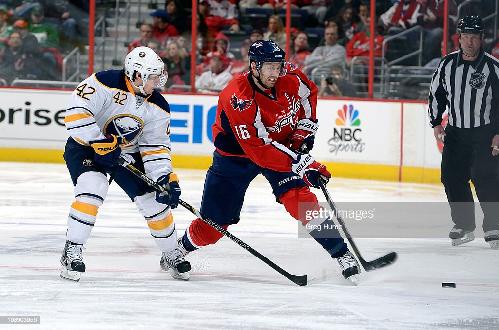 <a gi-track='captionPersonalityLinkClicked' href=/galleries/search?phrase=Eric+Fehr&family=editorial&specificpeople=566939 ng-click='$event.stopPropagation()'>Eric Fehr</a> #16 of the Washington Capitals clears the puck against <a gi-track='captionPersonalityLinkClicked' href=/galleries/search?phrase=Nathan+Gerbe&family=editorial&specificpeople=697084 ng-click='$event.stopPropagation()'>Nathan Gerbe</a> #42 of the Buffalo Sabres at the Verizon Center on March 17, 2013 in Washington, DC.