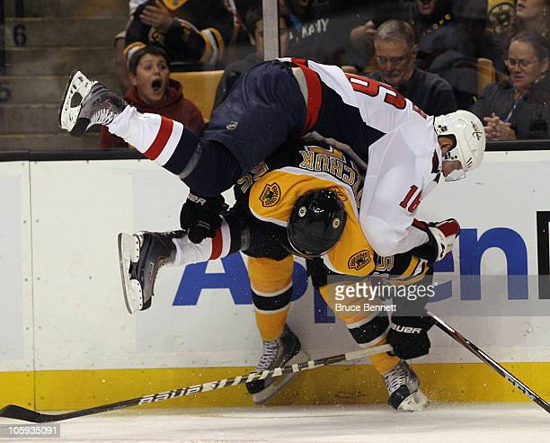 Eric Fehr of the Washington Capitals flips over Johnny Boychuk of the Boston Bruins at the TD Garden on October 21 2010 in Boston Massachusetts